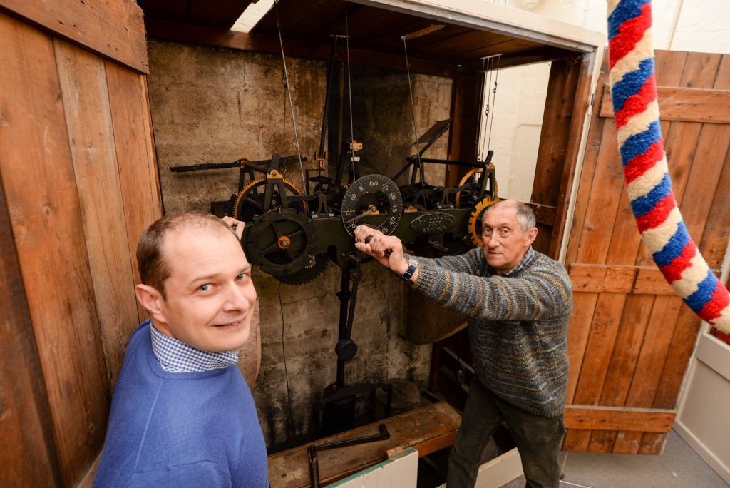 The restoration of the clock at All Saints Church in Oakham. Louis Totaro with Nigel Campion winding the clock Photo: Alan Walters (courtesy Rutland & Stamford Mercury)